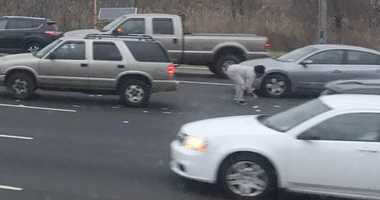 People stopped to pickup cash after a Brink's truck spilled on Route 3.