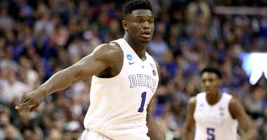 Zion Williamson points on defense during a game at Duke.