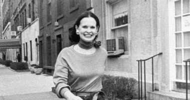 In this undated file photo heiress and designer Gloria Vanderbilt walks down a New York street. Vanderbilt died on Monday, June 17, 2019, at 95, according to her son, CNN anchor Anderson Cooper.