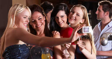 Group of women drinking at the bar.