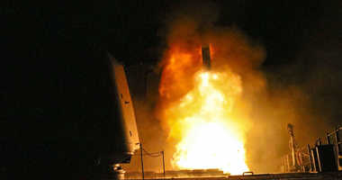 In this image provided by the U.S. Navy, the guided-missile cruiser USS Monterey (CG 61) fires a Tomahawk land attack missile Saturday, April 14, 2018, as part of the military response to Syria's use of chemical weapons on April 7.