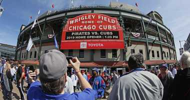 Chicago Cubs fans arrive at Wrigley Field.