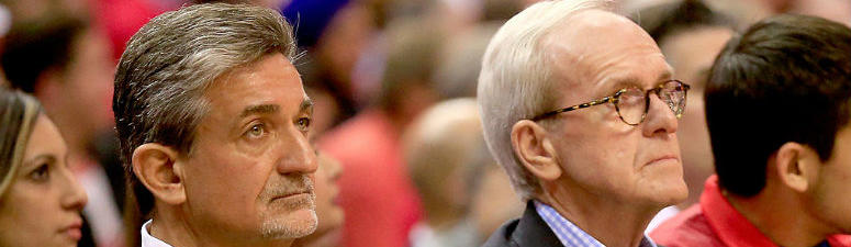 Ted Leonsis sits courtside at a Wizards game.