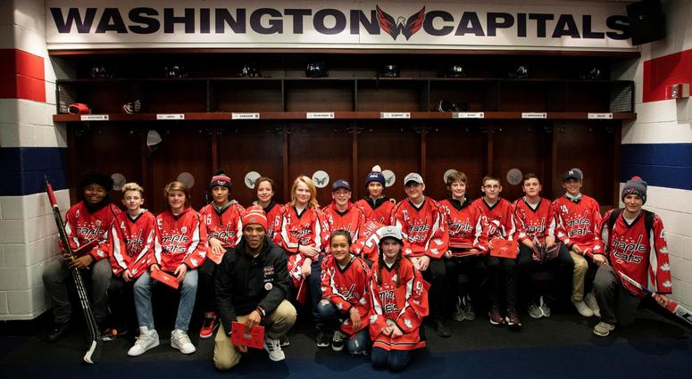 The Metro Maple Leafs pose for a team photo in the Capitals locker room