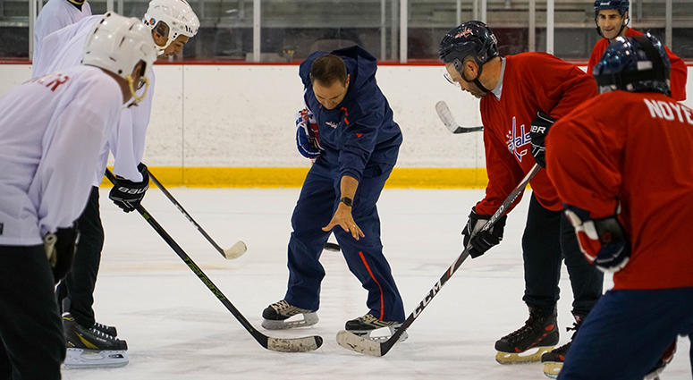 Sports Junkies host John 'Cakes' Auville takes the face-off in the 2019 Capitals Media Fantasy Camp