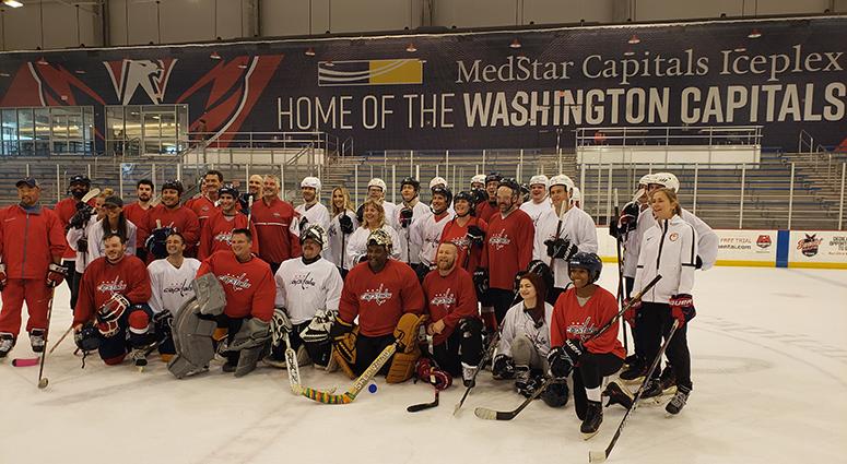 The assembled D.C. sports media take a team photo