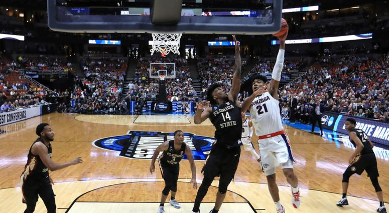 Rui Hachimura drives to the basket against Terance Mann of Florida State in the 2019 NCAA Men's Basketball Tournament