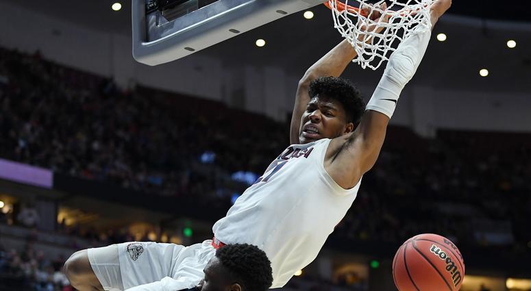 Rui Hachimura dunks on Mfiondu Kabengele of Florida State during the 2019 NCAA Men's Basketball Tournament