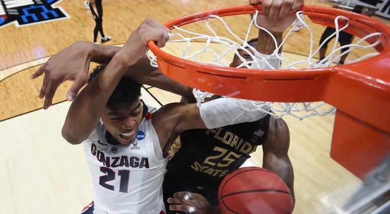 Rui Hachimura of the Gonzaga Bulldogs dunks the ball against Mfiondu Kabengele of the Florida State Seminoles during the 2019 NCAA Men's Basketball Tournament