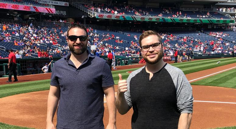 Danny Rouhier and Grant Paulsen on the field at Nats Park.