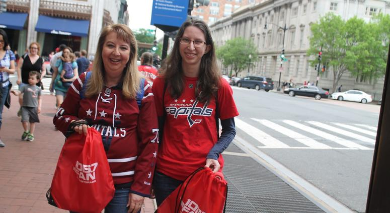 The 106.7 The Fan Street Team hangs out with fans before the Capitals vs. Penguins game at the Capitol One Arena.