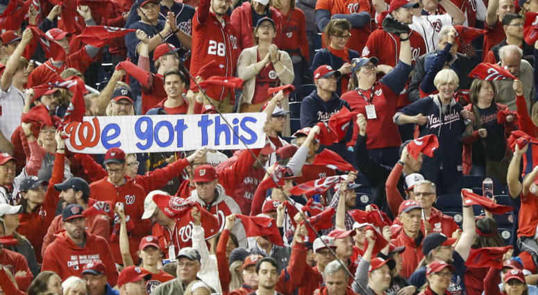 Nationals fans hold a sign during the first inning of Game 3 of the NLCS.