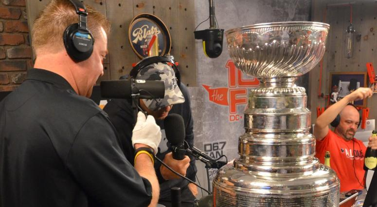 The Keeper of The Cup, Mike Bolt of the Hockey Hall of Fame, presents the Stanley Cup to The Junkies