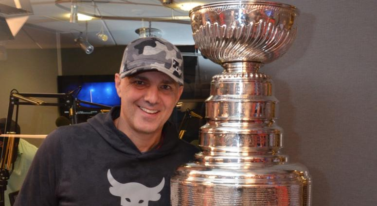 Eric 'EB' Bickel of The Sports Junkies poses with The Stanley Cup