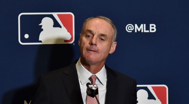 MLB Commissioner Rob Manfred and MLBPA director Tony Clark in war of words.