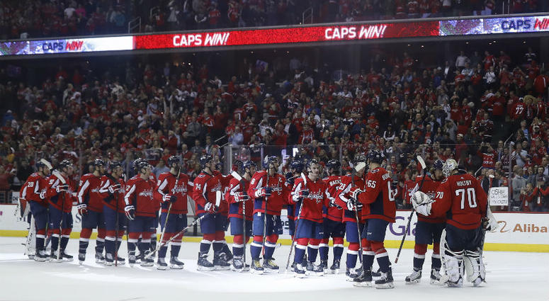 Washington Capitals celebrate their fourth consecutive division title.