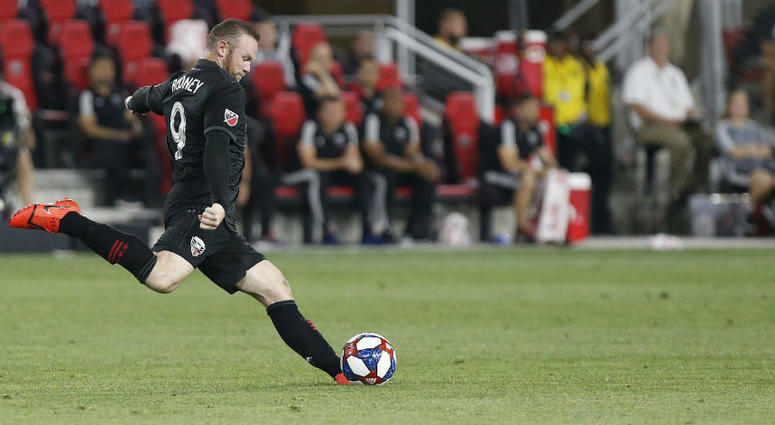 D.C. United's Wayne Rooney scores an absurd goal from his own half.