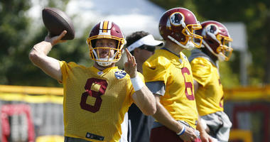 Redskins QB Case Keenum makes a throw at training camp.