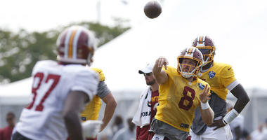Case Keenum throws a pass at Redskins training camp.