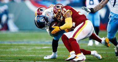 Redskins LB Mason Foster tackles Titans WR Corey Davis