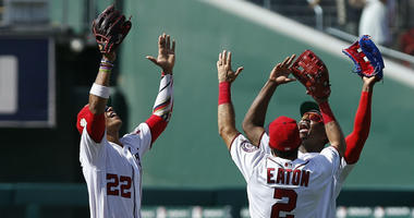 The Nationals celebrate after a win over the Royals.