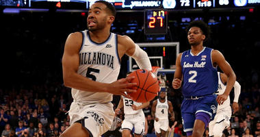 Villanova's Phil Booth dribbles ahead of the Seton Hall defense during the 2019 Big East tournament.