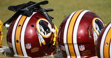 Redskins helmets sit on the field prior to practice.
