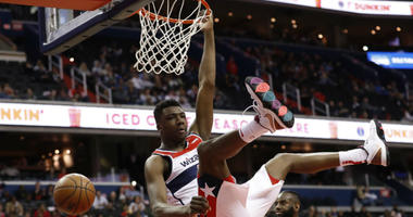 Thomas Bryant re-signs with the Washington Wizards.