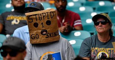 Redskins fans hide faces, protest Bruce Allen in Miami