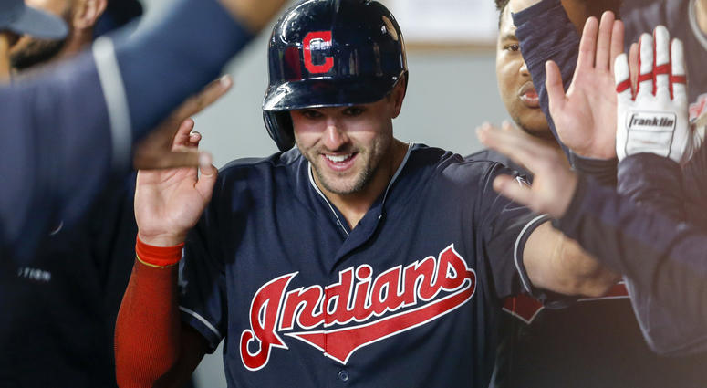 Apr 1, 2018; Seattle, WA, USA; Cleveland Indians right fielder Lonnie Chisenhall (8) is greeted in the dugout after scoring a run against the Seattle Mariners during the second inning at Safeco Field.