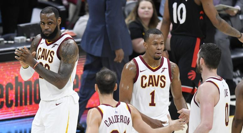 Cavaliers forward LeBron James (23) celebrates with guard Jose Calderon (81), guard Rodney Hood (1) and center Kevin Love (0) in the second quarter against the Toronto Raptors at Quicken Loans Arena.