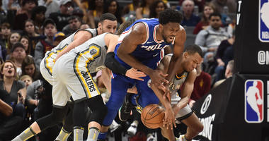 Cleveland Cavaliers guard Rodney Hood (1) and Philadelphia 76ers center Joel Embiid (21) battle for a loose ball during the second half at Quicken Loans Arena.