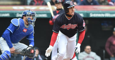 Cleveland Indians left fielder Michael Brantley (23) hits an RBI single during the first inning against the Kansas City Royals at Progressive Field.