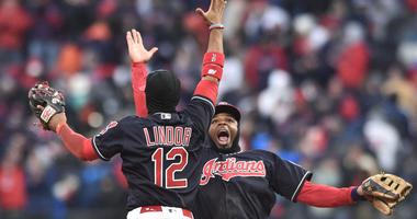 Cleveland Indians shortstop Francisco Lindor (12) and center fielder Rajai Davis (26) celebrate after defeating the Kansas City Royals at Progressive Field.