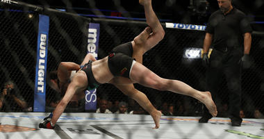 Tecia Torres (blue gloves) fights Rose Namajuanas (red gloves) in the women's straw weight bout (bout 10) during UFC Fight Night at Amalie Arena