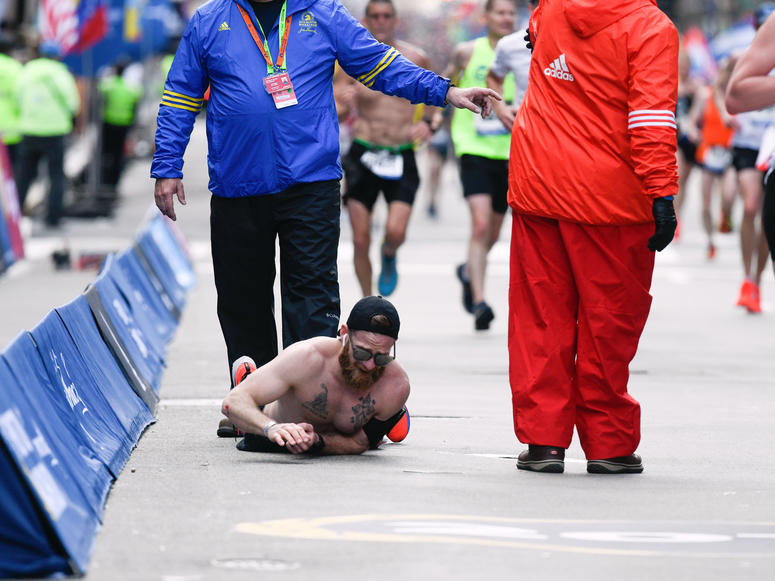 Apr 15, 2019; Boston, MA, USA; Micah Herndon crawls to the finish line of the 2019 Boston Marathon. Mandatory Credit: Brian Fluharty-USA TODAY Sports