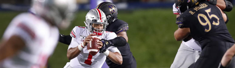 Ohio State quarterback Justin Fields (1) escapes pressure from Northwestern defensive end Earnest Brown IV during the first half of an NCAA college football game Friday, Oct. 18, 2019, in Evanston, Ill.