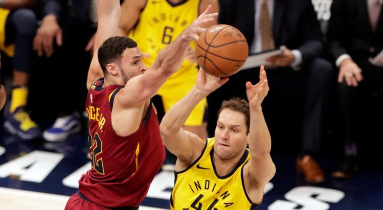 Indiana Pacers forward Bojan Bogdanovic (44) makes a pass in front of Cleveland Cavaliers forward Larry Nance Jr. (22) during the first half of Game 3 of an NBA basketball first-round playoff series