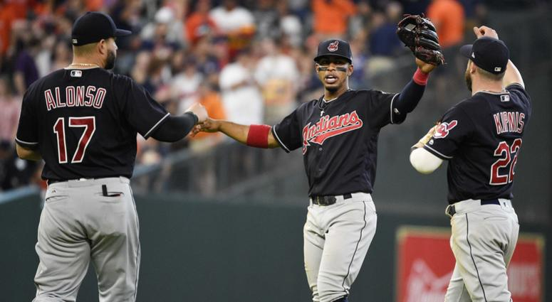 Cleveland Indians' Yonder Alonso (17), Francisco Lindor, center, and Jason Kipnis celebrate their win over the Houston Astros in a baseball game, Saturday, May 19, 2018, in Houston.