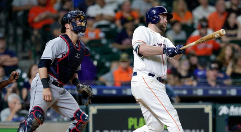 Houston Astros catcher Brian McCann (16) watches his two-run home run ball in front of Cleveland Indians catcher Yan Gomes during the seventh inning of a baseball game, Sunday, May 20, 2018, in Houston.