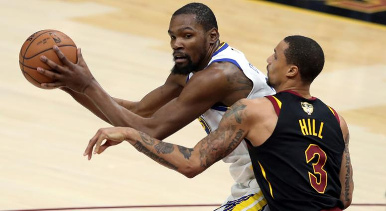 fb01645a1 Golden State Warriors  Kevin Durant is defended by Cleveland Cavaliers   George Hill during the
