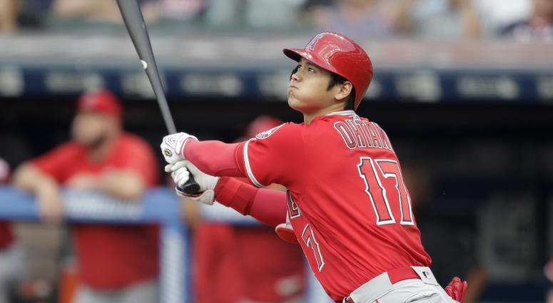 Los Angeles Angels' Shohei Ohtani watches his two-run home run off Cleveland Indians starting pitcher Mike Clevinger during the first inning of a baseball game Friday, Aug. 3, 2018, in Cleveland.
