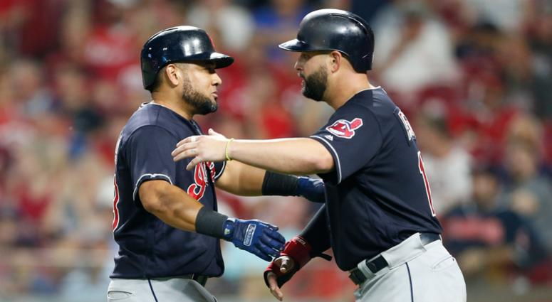 Cleveland Indians' Melky Cabrera, left, gets a hug from Yonder Alonso following Cabrera's a two-run home run off Cincinnati Reds relief pitcher Cody Reed during the sixth inning of a baseball game Wednesday, Aug. 15, 2018, in Cincinnati.