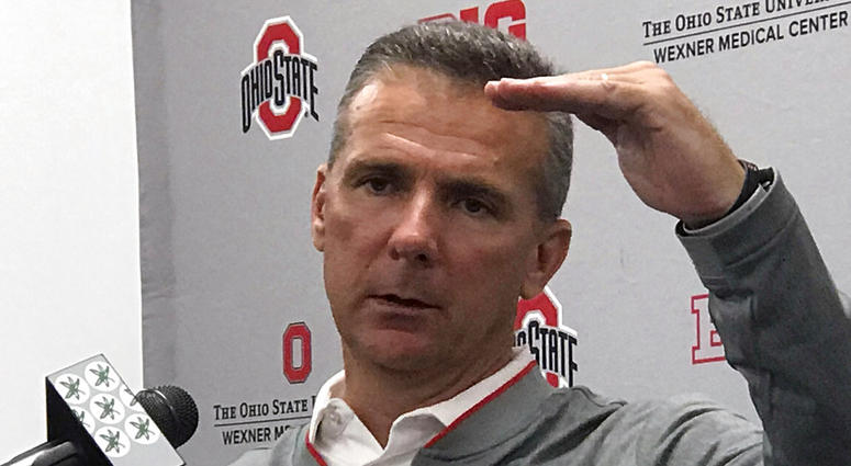 Ohio State NCAA college football head coach Urban Meyer gestures while speaking at a press conference in Columbus, Ohio, Monday, Sept. 17, 2018.