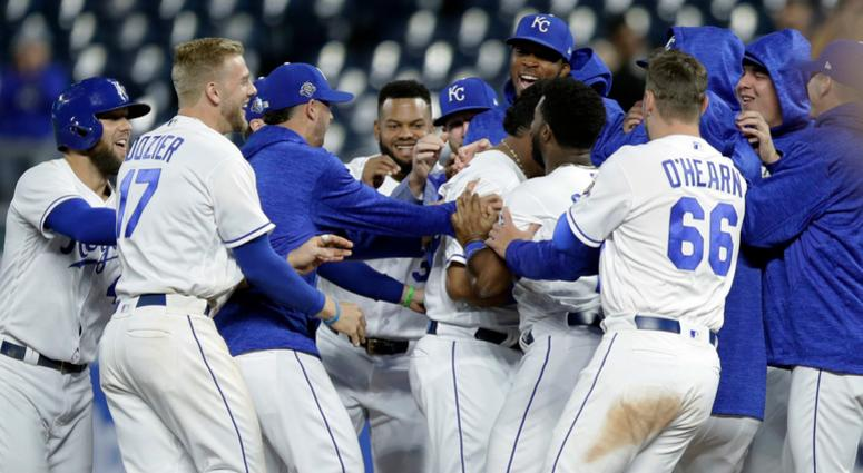Kansas City Royals mob designated hitter Salvador Perez after he drove in the winning run during the 10th inning of a baseball game against the Cleveland Indians at Kauffman Stadium in Kansas City, Mo., Thursday, Sept. 27, 2018. The Royals defeated the In
