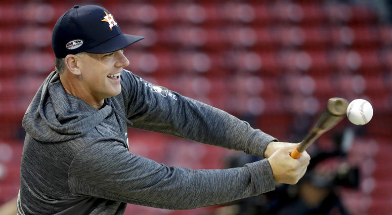 Houston Astros manager AJ Hinch hits during batting practice before Game 2 of a baseball American League Championship Series against the Boston Red Sox on Sunday, Oct. 14, 2018, in Boston.