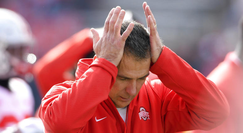In this Saturday, Nov. 17, 2018 photo, Ohio State head coach Urban Meyer holds his hands to his head before an NCAA football game against Maryland in College Park, Md. Urban Meyer doesn't seem to be having much fun these days. The Ohio State coach is not