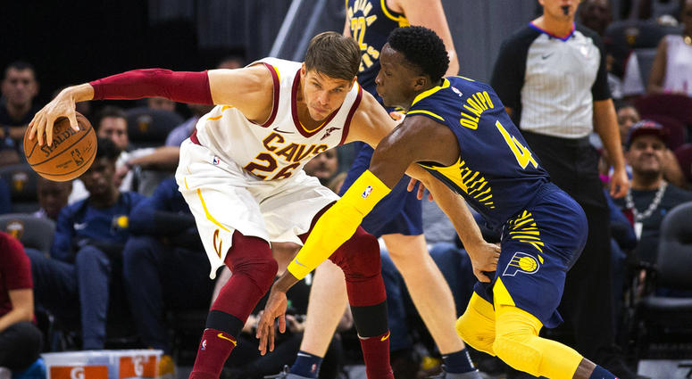 1690dcfbe Cleveland Cavaliers forward Kyle Korver (26) keeps the ball away from  Indiana Pacers guard