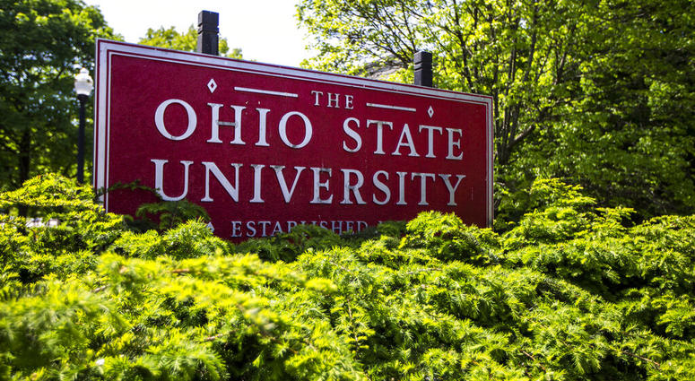 This May 8, 2019 photo shows a sign for Ohio State University in Columbus, Ohio. On Friday, May 17, 2019, the school said at least 177 men were sexually abused by Ohio State team doctor Richard Strauss who died years ago, according to findings from a law