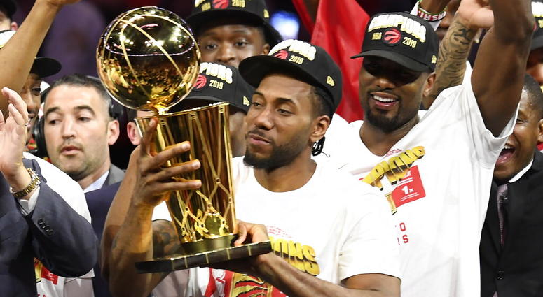 Toronto Raptors forward Kawhi Leonard holds Larry O'Brien NBA Championship Trophy after the Raptors defeated the Golden State Warriors 114-110 in Game 6 of basketball's NBA Finals, Thursday, June 13, 2019, in Oakland, Calif. (Frank Gunn/The Canadian Press